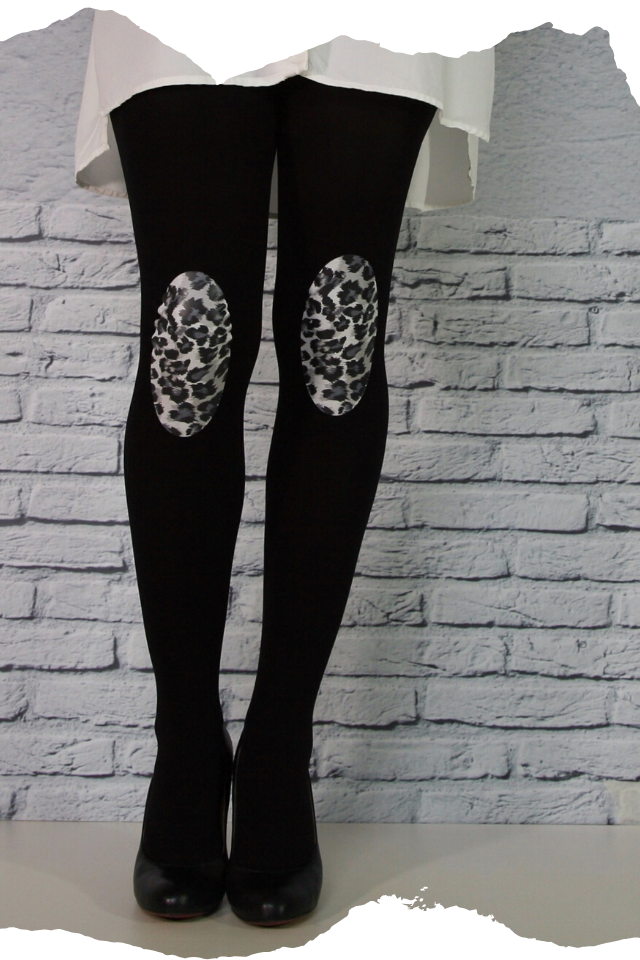 Pantis negros tupidos con rodilleras de leopardo, animal print